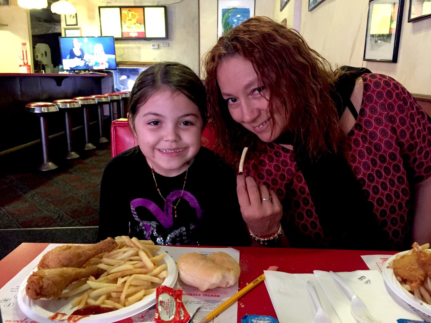 Jazlynn and mom at restaurant eating fries