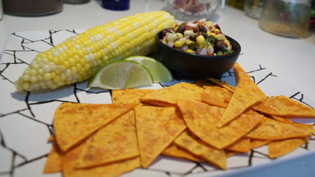 Black Bean Corn Salsa served with a corn cob and toasted tortillas